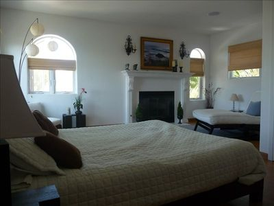 Guest suite with fireplace, queen bed and separate sitting area