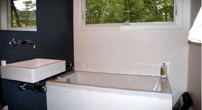 East Hampton cabin rental - Bathroom. Large soaking tub with picture window.