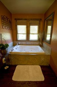 Jacuzzi Tub in Master Suite  Bathroom has double sinks & shower.