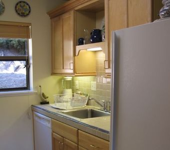 Kitchen has a full-sized fridge and dishwasher.