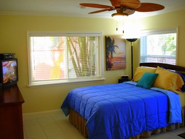 Siesta Key villa rental - Tommy Bahama Rattan Fan over pillow-top Queen Bed