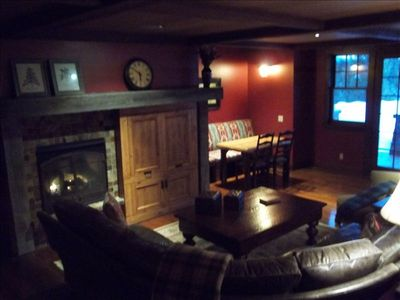 Game room w/ huge sofa, seating for casual dining, gas fireplace and flatscreen