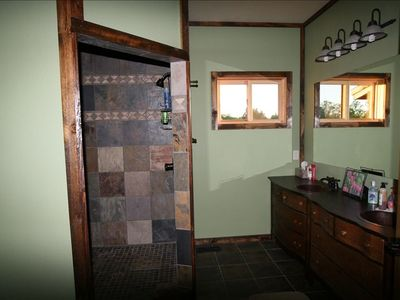 Main level bath with walk-in shower; similar to upper level bath.