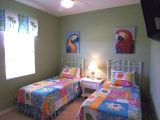Cape Coral house photo - Guest Bedroom. Two twin beds, oversized closet and 22 inch LCD TV DVD