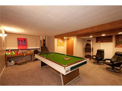 games room with toys for children and seating area