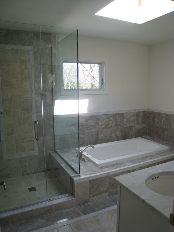 new master bath w double sink, skylight, jacuzzi