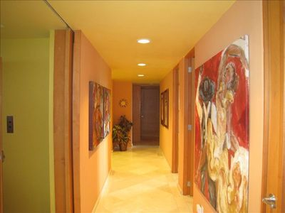 Expansive hallway appointed with local art to enhance your P.V. experience