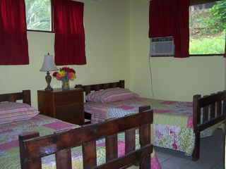 Playa Flamingo condo photo - Second bedroom, 2 twin beds w/ new bed covers & curtains.