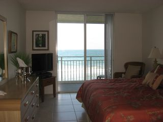 Indian Harbour Beach condo photo - Balcony overlooks large heated pool and uncrowded beach