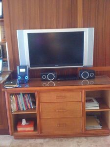 Flat screen on pivot, iPod/MP3 dock, DVD player