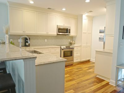 Completely renovated kitchen with hardwood floors, appliances, granite counters