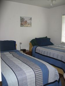 2 twin beds in second bedroom