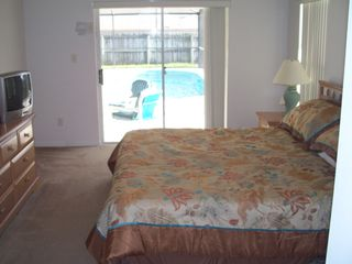 Orange Tree house photo - Master Bedroom with sliding glass doors to the lanai and pool area.