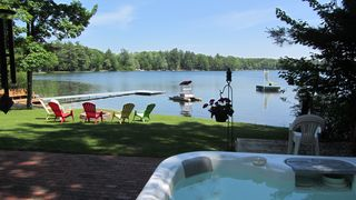 Interlochen cottage photo - Sit in the hot tub and relax