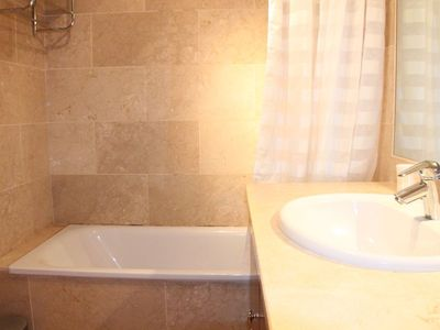 Marbella Town apartment rental - Master ensuite bathroom leading to wardrobe area