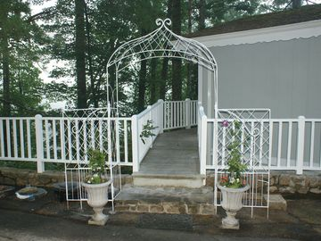 Entrance to back porch with flowers and vines