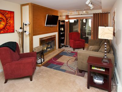 Living room with gas fireplace, flat screen tv, new pullout sofa