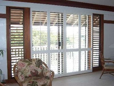 The plantation shutters allow the room to feel bright & cheerful but not hot!