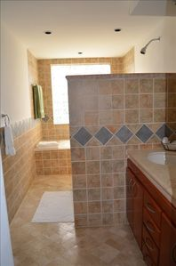 All 4 bathrms are tiled with marble floors 5th bathroom on the roof is standard