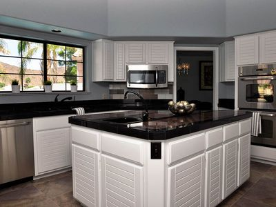 Beautiful Chef's kitchen with large center island and prep sink