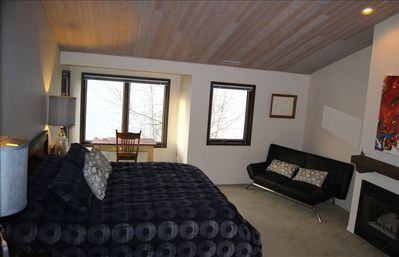 Master Bedroom: views south and east across the lake. King bed and futon.