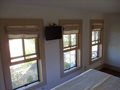 Bedroom has three windows