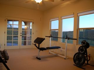 Albuquerque house photo - Gym room with great views. More equipment is being added soon.