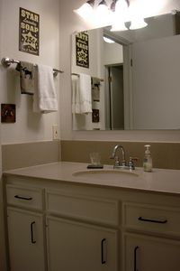 Sparkling clean bathroom with corian counter tops.