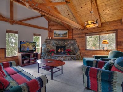 Comfortable living room with river rock fireplace