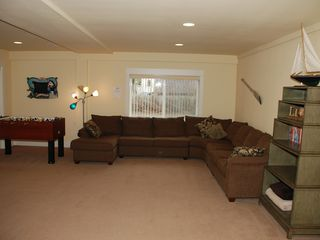 Lincoln City house photo - HUGE Media Room w/sleeper sofa, big screen TV & LOTS of Entertainment