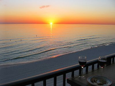 Relax at the balcony bar after a great day at the beach and watch the sun set.