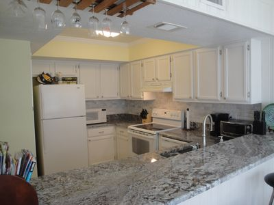 New kitchen complete with marble backsplash and granite counter tops