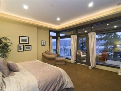 one of four luxurious guest bedrooms, flat screen, king bed, private balcony