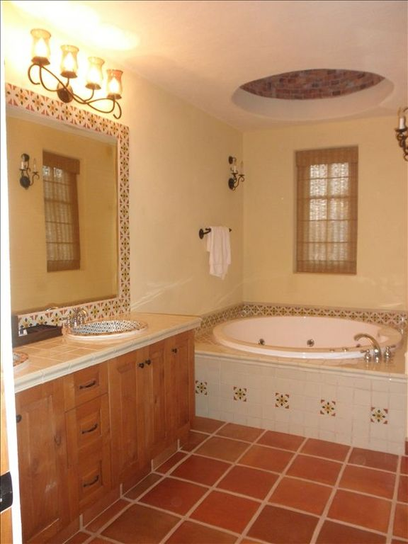 Upstairs master bathroom with double sink vanity, soaking tub, shower, & toilet