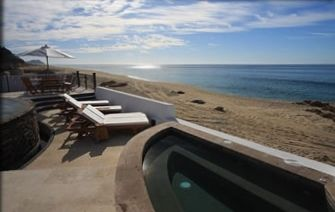 Tranquil, semi-private beach; Jacuzzi holds up to 12 people