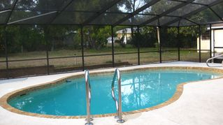 Winter Haven house photo - Private Pool with Screened Enclosure, Patio Set