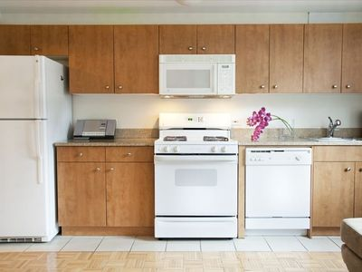 The kitchen is complete with standard fridge, gas range, microwave & coffeemaker