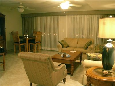 Turn and you see the Living Room/Dining Room Area with entertainment cabinet/TV
