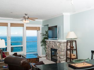 Lincoln City condo photo - Unwind In Comfortable Elegance With a Plasma TV and River Rock Fireplace