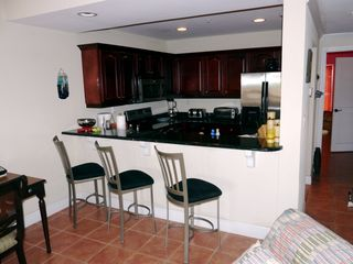 Cruz Bay condo photo - Full kitchen & breakfast bar with entrance to MBR suite in background of 1Br