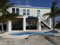 BRAND NEW 3 BED 2 BATH/ HEATED POOL / CANAL HOME