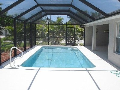 Screened lanai with southern exposure pool and elec heater with solar cover