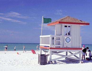 Walking North you will see the colorful life guard shacks at the public beach