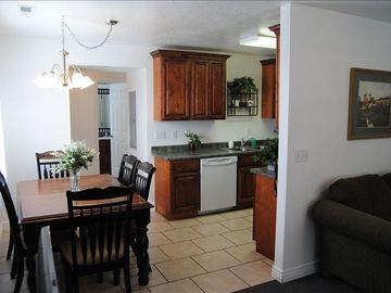 Cedar City townhome rental - Dining area with room for six adjoins a well appointed kitchen.