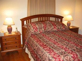 Downstairs Bedroom with Queen Bed and TV - Brewster cottage vacation rental photo