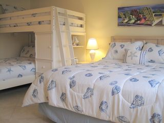 Cocoa Beach condo photo - Queen, Double and Twin bed in the guest bedroom