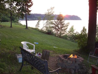 Sodus Bay cottage rental - View from fire pit area. Sunset starting on the point.