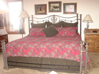 Large master bedroom with plenty of room including bureau and desk area.