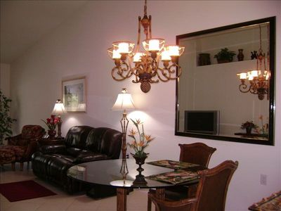 Large mirror in the dining area. New leather couch with electric recline.