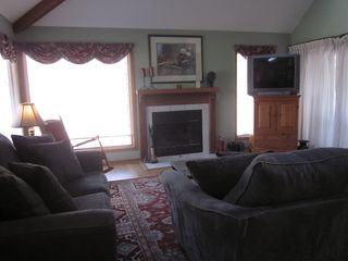 Galena house photo - Kick back and enjoy the fireplace and tv in the main level family room.